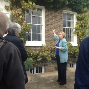 AMS Members listening to Joy Birney's tour of Kelmscott House
